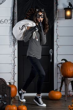 You need this cat burglar costume, right meow! Create the purrr-fect look with a black eye mask and a DIY money bag. Add in classic black and white stripes and cat ears. Meow! Featured product includes: cat ears headband, SO striped shirt and black Skinny jeans, Converse All Star high- tops, and Apt. 9 black suede gloves. Get your Halloween haunt on at Kohl's.