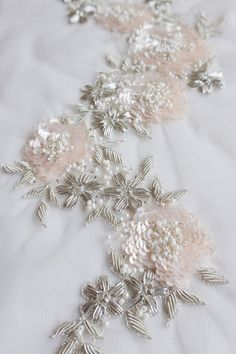 Hand-made motif with pale pink sequin flowers and silver wire embroideryEmbroidery Machine Not Stitching Embroidery Designs Pictures!how to do silk ribbon embroidery Zardozi Embroidery, Couture Embroidery, Hardanger Embroidery, Silk Ribbon Embroidery, Lace Ribbon, Embroidery Fashion, Hand Embroidery Designs, Embroidery Stitches, Embroidery Kits
