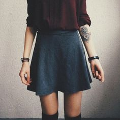 I love the darker colors here. And the socks. The baggyish shirt in the a-line skirt makes a great silhouette