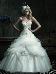 2012 Beautiful Low Waistline Ivory Ball Gown Wedding Dress  Starting at: $299.63    2012 Beautiful Low Waistline Ivory Ball Gown Wedding Dress C186F.The fitted bodice features a sweetheart neckline and rich embellishment throughout. Beautiful flowers accent the soft pick-ups in the tulle ball gown skirt.