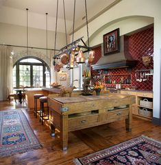 Kitchen in former table - tiles hung on diagonal,  meat rack as pot rack, vintage butcher block table
