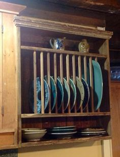 New plate rack made from old boards. Perfect way to show off and store local pottery.