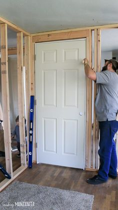 If you're renovating, chances are there will come a time when you need to install a prehung door. This how to install a prehung door tutorial is just for you! Whether it's a door that you're adding to a wall or just that you are replacing old, tired doors Prehung Interior Doors, Prehung Doors, Porte Diy, Framing Construction, Building A Door, Build A Wall, Garage Remodel, Exterior Remodel, Kitchen Remodel