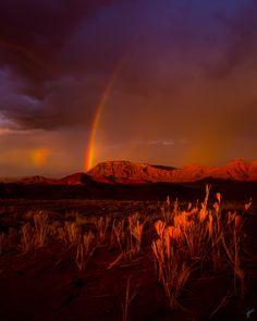 https://flic.kr/p/U21tun   Over the rainbow.   A rainbow after a rainstorm in Sossusvlei.