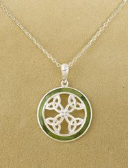 "Four Trinity Knot Circle Pendant:  The trinity knot, suggesting balance and harmony, is among the most venerable of Celtic designs. A ring of green Connemara marble from western Ireland encircles a cross of four joined trinity knots. Sterling silver, on 18"" chain. Made in Ireland."