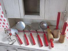 Vintage red handled kitchen utensils