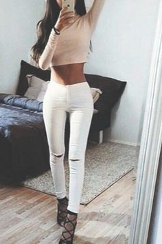 White Ripped Skinny Jeans With A Long Sleeved Beige Crop Top And Black Gladiator Heels