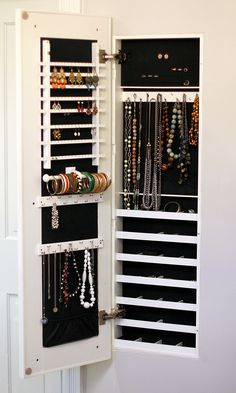This is great - ought one and built it into the wall.  The Family Jewels: Building a Concealed Jewelry Cabinet - Old Town Home