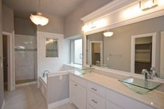 Spacious master bath with a double vanity, jetted tub, walk-in shower with window, water closet and large master closet. What else could you want?