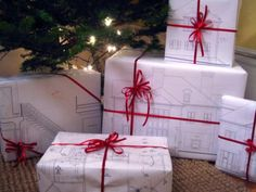 construction drawings as wrapping paper... did this for clients one year with colored rendering of their house, added an a personal touch!