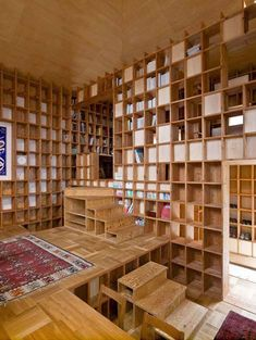 Wow! House of Storage - Japan. This 52 square meter (560 square feet) private home in Japan was designed to artfully store the client's massive collection of books. With pine shelves covering every wall surface, the open-plan home is a bibliophile's dream! Like a giant grid, the whole plan of the house (including furnishings) was based on the scale of the shelving.