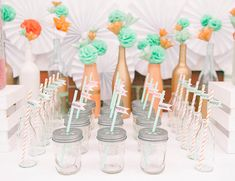 mason jars with lids and straws with flags for kids birthday party