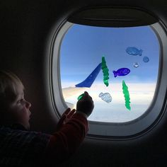 Window Clings are a great toddler activity for flying. Toddler. 1 year old. 2 year old. flight. airplane. busy.