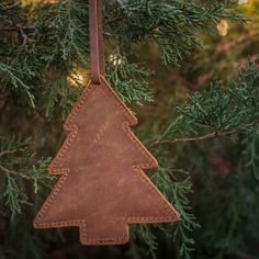 leather christmas ornaments  in tobacco leather in the shape of a tree pendant on Christmas tree