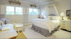 pam pierce ~   sweet girls room with gray & white linen + bleached french shelves above the windows.