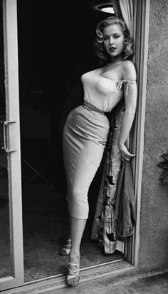 Betty Brosmer.. the highest paid pin-up girl of the 1950s, considered by many as the first true supermodel. Her waist measured 18 inches, her bust 38 inches and hips 36 inches. It's speculated she achieved her tiny waist with corset training, also known as waist training, waist reduction or tightlacing, for moulding a pronounced and significantly smaller waist, altering the shape of the ribcage in extreme cases and moving internal organs out of their original positions.