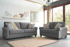 Blending a relaxed sensibility with a richly tailored profile, the Nalini sofa and loveseat set works a modern classic look that's incredibly versatile. Subtly rolled arms give the clean lines a touch of flirt and sense of flow. Plush upholstery, with a textured twill weave and soothing, dusty hue, is easy like a Sunday morning.