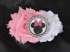 Minnie mouse clip. Pink and white shabby chic flowers with Minnie Mouse bottle cap. Available at www.facebook.com/missmollybowbolly