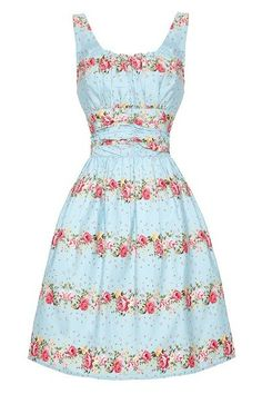 What a perfect little day Dress, the Angie Dress from Voodoo Vixen in the UK. Lovely rows of Pink, White and Cream Roses across a perfect blue background to really make the floral print pop in vintage 50's style.This sky-blue dress has a typical 50s wrinkled bust with wide straps and a stretchy back panel to ensure a perfect fit. The bodice is also wrinkled masking possible problem areas: super flattering! The flared pleated skirt is fully lined and hits  just above the knee.  Made from a…