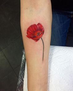 tiny poppy done @funcitytattoo !
