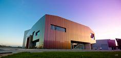 Instalacoes Poco Equipamentos Industriais, Leiria | Portugal by João Patricio Arquitectos   ALUCOBOND® spectra Red Brass
