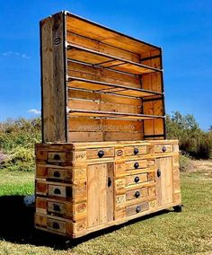 We have manager to incorporate a total of seventeen drawers to this classic refurbished wood pallet cabinet. This is really wonderful art work.