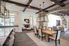 1 of 3 My PERFECT open floorplan dream remodel with brick detail, large dining and large kitchen.