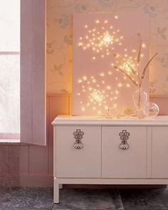4. Create Starry Wall Art By Punching Holes In A Canvas And Fitting The Lights In The Spaces!