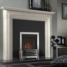 Perfect modern fireplace - White mantle, black surround and stainless gas fire