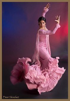 Beautiful movement with this flamenco dancer wearing a pink bata de cola. Photo: Paco Sanchez.