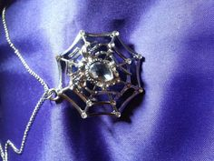 Hey, I found this really awesome Etsy listing at https://www.etsy.com/listing/224104322/costume-necklace-silver-spider-in-web