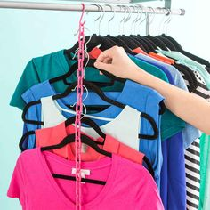 Triple your closet space by hanging multiple shirts on a length of chain.