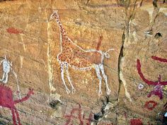 """""""Tadrart Acacus mountain range, located in the Sahara Desert, is renowned for its rock art that dates as far back 12,000 BC. The paintings are particularly interesting because they demonstrate that the area used to have a much wetter climate, due to the paintings of lakes and forests."""" - photo from Wikipedia, via heritagedaily"""