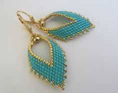 I purchased this pattern online (not Etsy) & slightly modified the pattern shape to make it my own... PLEASE DO NOT COPY, thank you! :)  These earrings are created using brick stitch, & take nearly 2-1/2 hours to complete.  These pretty Russian leaf earrings are handmade with Duracoat Galvanized mint green, & golden delica seed beads with golden Swarovski glass pearls. They measure just under 2 long including the plated leverback earwire. The leaf itself measures just under 1-1/2 long, & 7/8…