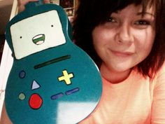 For you Adventure Time fans out there! This cool gal painted her ukulele to look like BMO!