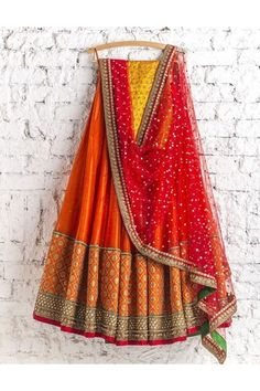Red bridal lehenga with sequins net dupatta by Swati Manish. Click on image to see price. #Frugal2Fab