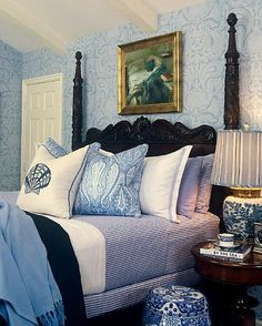 black bed with the blue and white.