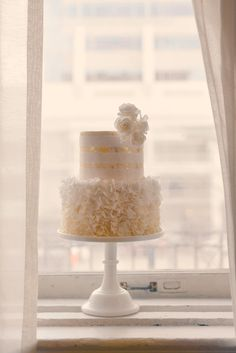 Elegant and chic wedding cake with ivory to white ombre ruffles with white stripes over gold leaf flecks. Adorned with white sugar roses. Ruffle Cake, Ruffles, Chic Wedding, Wedding Stuff, Sugar Rose, White Ombre, Cake Shop, Custom Cakes, Gold Leaf