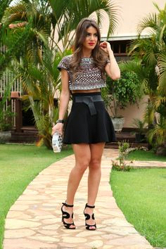 Sparkly patterned crop top // Black skater skirt with belt detailing // Assorted jewellery // Black cut-out heels