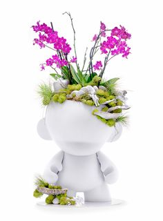 giant munny with orchids.. planter