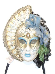 Genuine hand made masquerade mask from Venice, Italy. Collar fans around the face, edged with black and gold rick rack fabric and gold cord. Mask has black satin ties for wearing and a fabric loop for hanging. Venetian Masquerade Masks, Light Blue Flowers, Black Satin, Lion Sculpture, Skull, Statue, Mardi Gras, Fabric, Fan