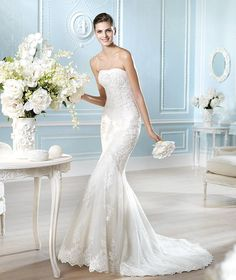 """Carrie Karibo just received this beautiful San Patrick gown! The """"Atlanta"""" gown is so feminine with lovely lace appliques."""