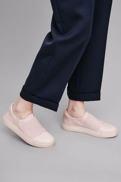 A clean minimal style and a slip-on design, these sneakers are made from panels of smooth leather with an elastic wrap-over detail and completed with a comfortable rubber sole.