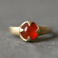 Visibly Interesting: Michelle Chang Carnelian cabochon ring in pronged Brass setting.