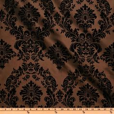 Flocked Damask Taffeta Brown from @fabricdotcom  This lightweight fabric has a beautiful flocked velveteen damask design. It's appropriate for everything from skirts and jackets to window treatments, pillows and duvet covers. Colors include black flocking on a brown background.