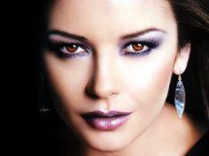 Purple ~ LOVE the way Catherine Zeta-Jones wears hers...reminds me of my mom. :)