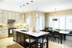love all the seating options in this kitchen