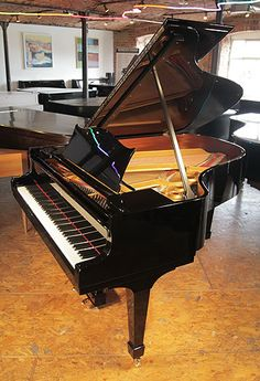 A 1929, Steinway Model O grand piano with a black case and spade legs at…