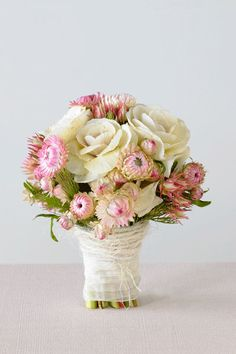 Clustered posy of pink blushing bride, pink paper daisy, white kale, thryptomene and woolly bush. Available in winter and spring from Maria Lush.