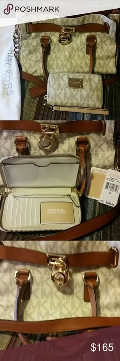 Michael Kors Hamilton satchel with wallet 100% Authentic signature Hamilton tote with matching wallet. Perfect condition. Only toted a couple of times. MICHAEL Michael Kors Bags Satchels